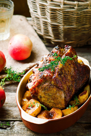 roast meat: Roasted Pork Rack with Apples.style rustic.selective focus Stock Photo