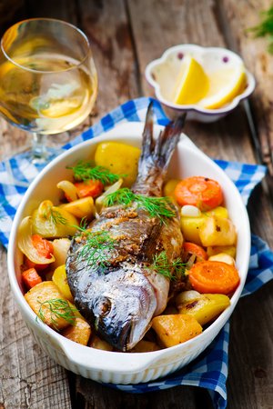 Oven Baked Fish and Vegetables.seletive focus