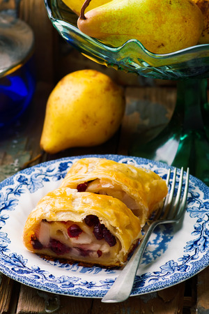 strudel: Pear and cranberry  strudel .selective focus. style rustic