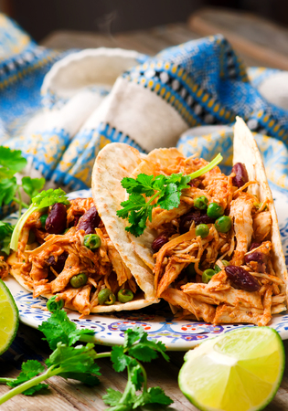 slow cooker: Slow Cooker Shredded Chicken Tex-Mex.selective focus Stock Photo