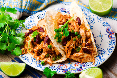 Slow Cooker Shredded Chicken Tex-Mex.selective focus Stock Photo