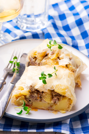 strudel with potatoes and forcemeat..selective focus. style rustic Stock Photo