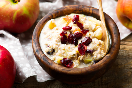 overnight oats with apples cranberrie and cinnamon.selective focus Stock Photo