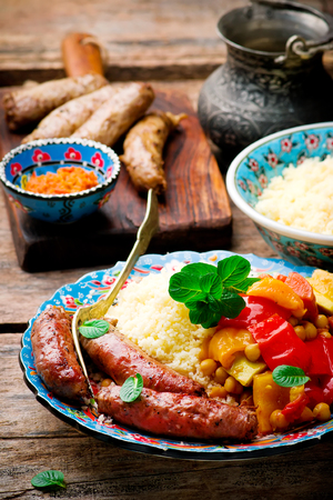 Couscous and Merguez Sausages.selective focus