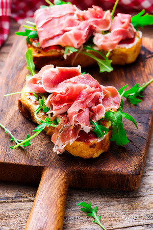 hams: Cranberry  Prosciutto and cream  Cheese sandwich.selective focus.style rustic