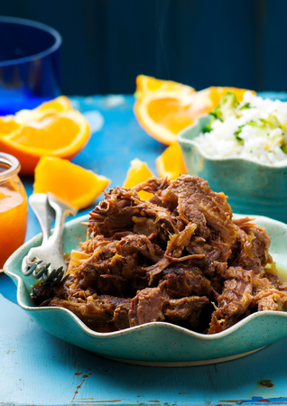 Slow Cooker Braised Pork with a Rum-Orange Sauce.selective focus Stock Photo