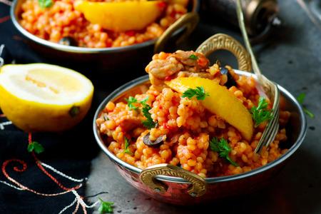 lemony: lemony chicken stew giant couscous..selective focus