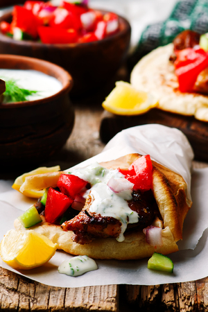 greek chicken gyros with tzatziki.selective focus
