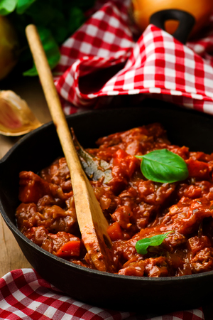 ragout with meat and vegetables in a frying pan. style rustic .selectve focus Stock Photo