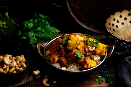 pumpkin curry chicken over cashew rice. selective focus 스톡 콘텐츠