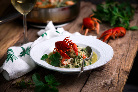 risotto with nettles and crayfish.style rustic.selective focus Standard-Bild