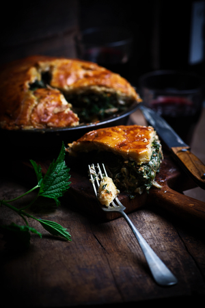 Chicken and nettle pie..style rustic.selective focus