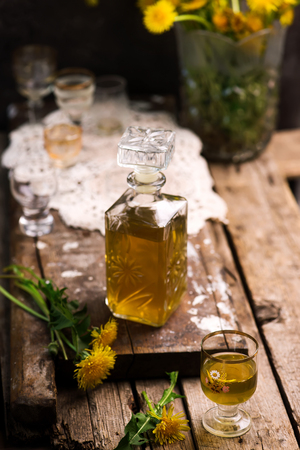 Dandelion Cordial in glass bottle .style vintage. selective focus Stock Photo