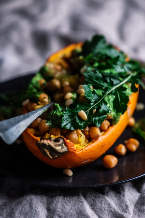 STUFFED SPAGHETTI SQUASH WITH CHICKPEAS and GARLICKY ARUGULA CREAM.selective focus Standard-Bild