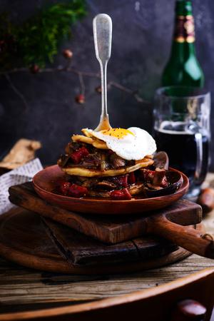 Irish potato pancakes with sausage beer stew. Rustic style. Selective focus