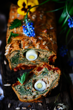 Wild Nettle whole grane loaf with eggs. Style rustic. selective focus