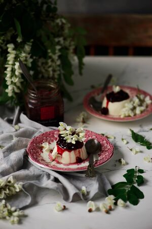 pannacotta with acacia flowers and cherry sauce..selective focus Banque d'images