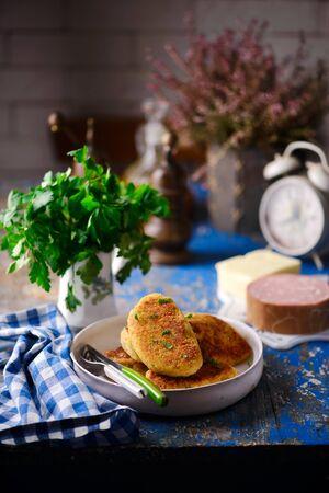 potato patties with mortadella and mozzarella. style rustic. selective focus