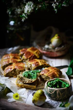 savoury cheddar and wild garlic hot cross buns.traditional  easter pastries. selective focus Reklamní fotografie