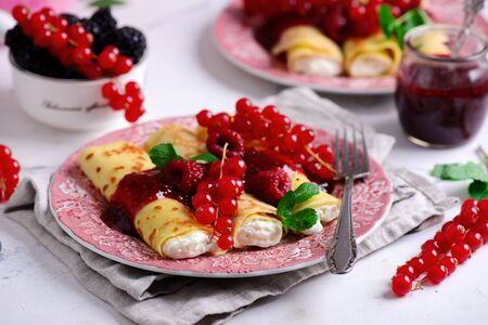 Crepes with lemon cream and raspberry jam..selective focus. style vintage