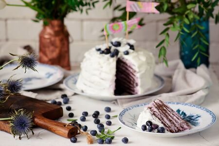 Almond crepe cake with blueberry cream..selective focus. style vintage