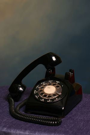 miscommunication: Retro black rotary desk phone off the hook