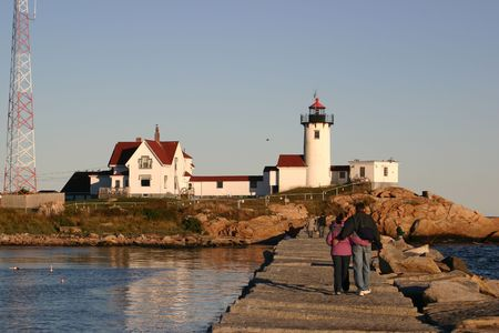 People Strolling on the Breakwater at Eastern Point Light