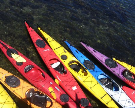 A rainbow of kayaks Reklamní fotografie