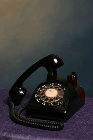 Retro black rotary desk phone off the hook