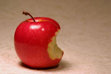 temptations: Bitten red apple