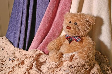 Teddy bear with blankets and lace Reklamní fotografie