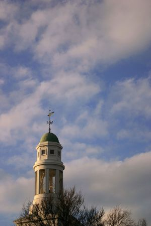 Church clock tower surrounded by sky photo