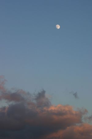 gibbous: Gibbous moon over dreamy sunset clouds