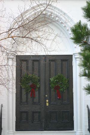 Black church doors dressed for winter Reklamní fotografie