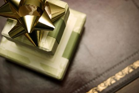 Green toile gift boxes with gold bow close up. Reklamní fotografie