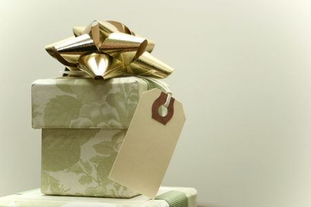 Green toile gift box with gold bow