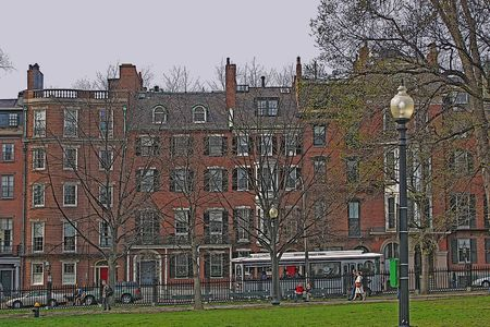 Brownstone buildings line the edge of Boston Common on Beacon Hill.