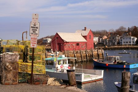 Landmark, Motif #1 surrounded by boats and lobster traps on a sunny day. photo