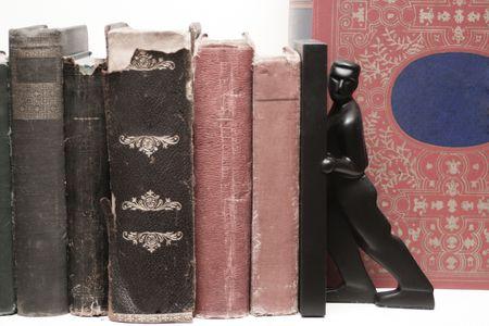 Desaturated image of red and black old books Reklamní fotografie