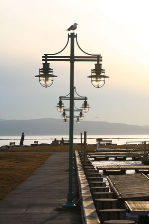 a centered row of lamp posts leading out to the waterside