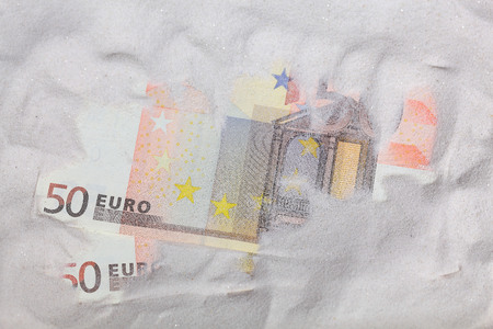 possession: Euro Notes in sand Stock Photo