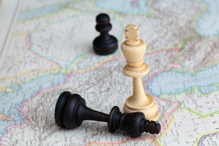 Chess figures on a historical map