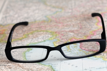 international monitoring: Glasses on a map