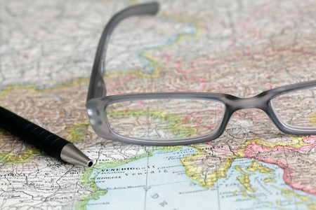 international monitoring: Glasses and pan on a map
