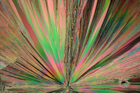 Gadolinium is a rare earth element. The crystals are precipitated from a solution on a microscope slide and photographed in polarized light.