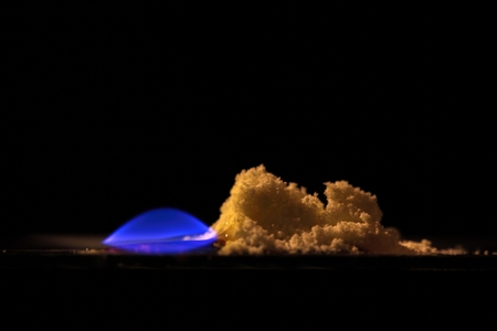 chemically: A macro photography of burning sulfur powder. Stock Photo