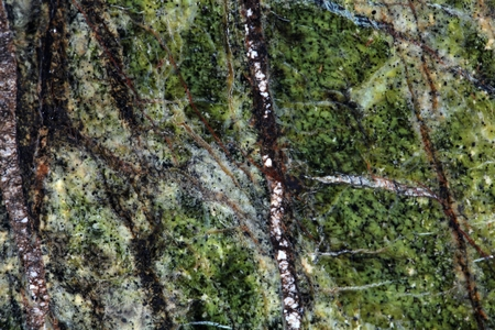 mineralogy: Macro photography of the polished surface of a metamorphic serpentinite rock. Stock Photo
