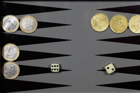 backgammon: Euro coins on a backgammon board