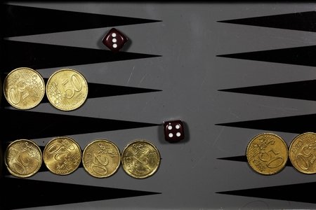 batch of euro: Euro coins on a backgammon board