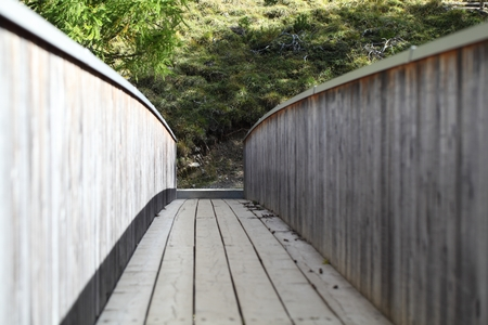 peaceably: A wooden bridge in the Alps.